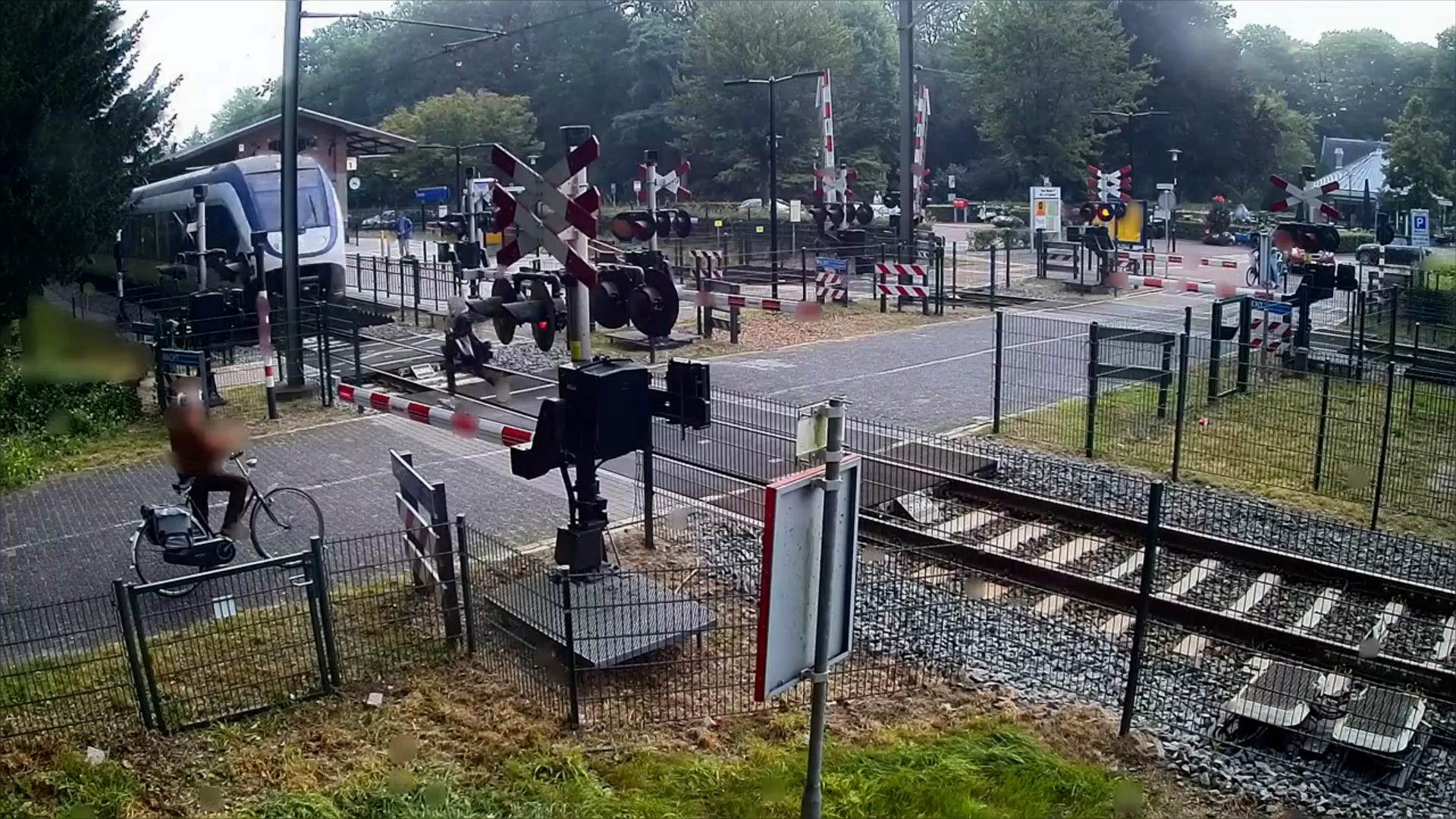 A woman in the Netherlands narrowly avoids being hit by a train while crossing tracks
