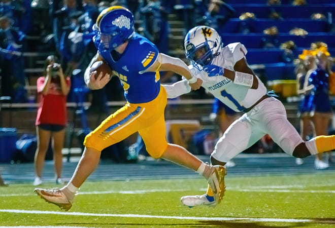 Anderson running back Colin Page steps into the end zone for a touchdown as Pflugerville's Donald Springs chases him in the third quarter Thursday night. Page finished with 219 yards and three touchdowns.