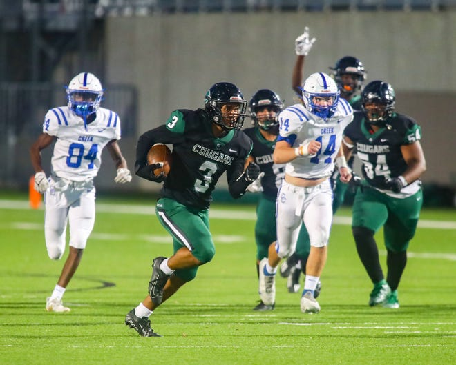 Connally's Averil Houston takes a first-half punt return back for a touchdown against Cedar Creek at their District 13-5A DII game Sept. 23 at The Pfield in Pflugerville. Connally pulled away for a 52-28 win.