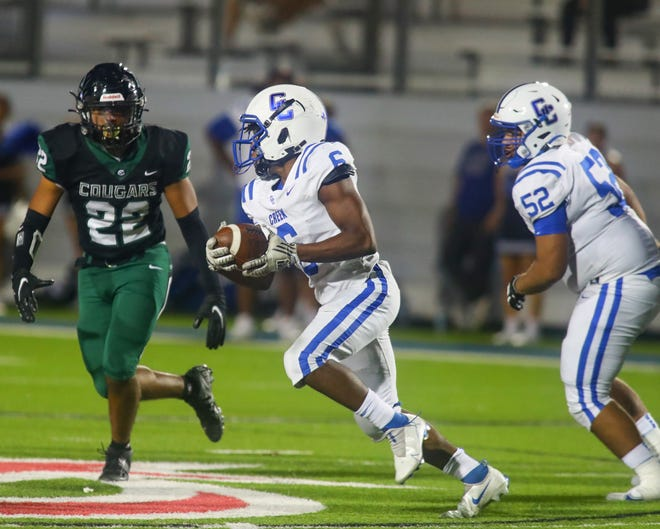 Davin Winston and Cedar Creek try to run away from Connally and Aden Ramirez, 22, during district play Sept. 23 at the Pfield. Connally took the win by a final margin of 52-28.