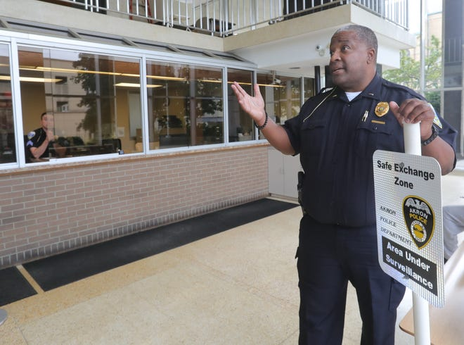 Police spokesman Lt. Michael Miller talks about the safe exchange zone in the lobby of the Akron Police Department.