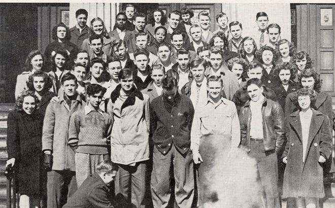 Members of the Black Arts Club, a student chemistry group at Central High School in Akron, take a portrait in 1946. Note the cloud of smoke at the bottom, apparently a chemical reaction set off by the boy kneeling at left. Later that year, hundreds of students went on strike over cafeteria prices.