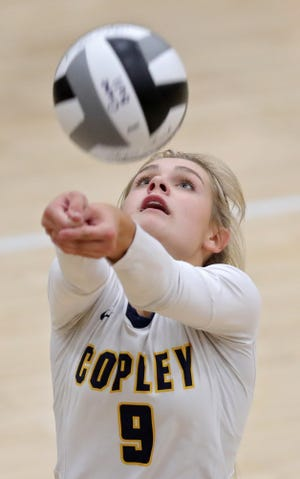 Copley's Lydia Pavlovich gets under a ball during the fourth set of a volleyball match against Aurora on Thursday night. [Jeff Lange/Beacon Journal]