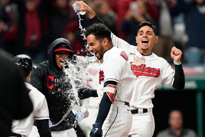 Cleveland outfielder Oscar Mercado, center, is mobbed by teammates after hitting a two-run home run in the seventh inning of the second game of a doubleheader against the Chicago White Sox to give Cleveland a 5-3 win and a split Thursday night. [Tony Dejak/Associated Press]