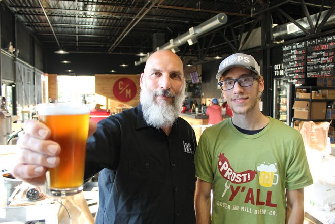 From left, Shawn Childress, brewmaster and co-founder of Cooper and Mill Brewing Company, and his son and brewer, Asher Childress, gear up for Oktoberfest.