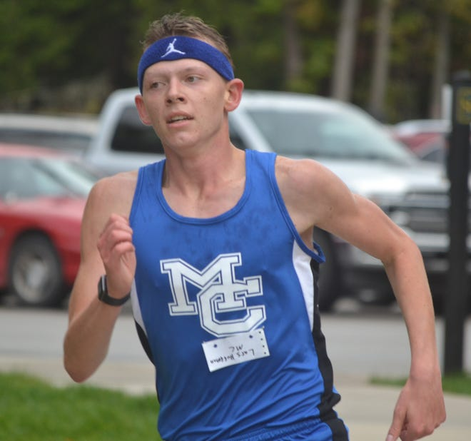 Mackinaw City's Lars Huffman heads for a first-place finish during the third Northern Lakes Conference meet on Thursday.
