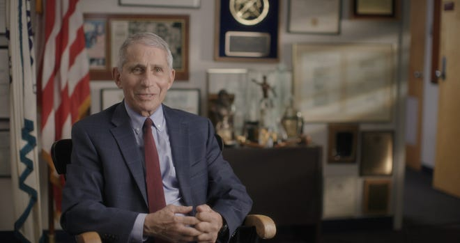 """In a scene from """"Fauci,"""" Dr. Anthony Fauci is seated in his office at the National Institute of Allergy and Infectious Diseases."""