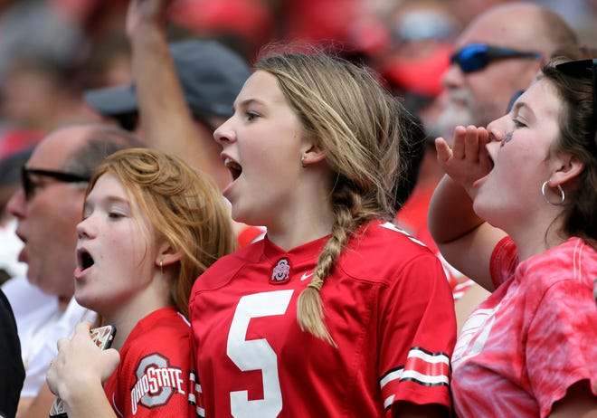 Ohio State fans cheer during the game against Oregon at Ohio Stadium on Sept. 11.