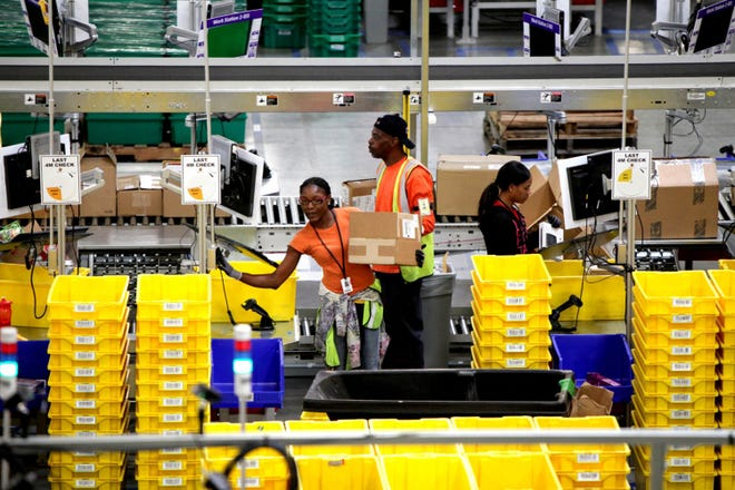 Workers at Amazon's Fulfillment Center in San Bernardino, California. Amazon.com Inc. A new study has found 60% of the company's lowest-paid hires from 2018 to 2020 were Black or Hispanic. (Irfan Khan/Los Angeles Times/TNS)