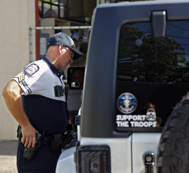 Columbus police Sgt. Fred Brophy issues a warning to a driver from Hilliard after the veteran officer spotted a known prostitute leaving the man's vehicle on Sullivant Avenue in Franklinton in this 2019 file photo.