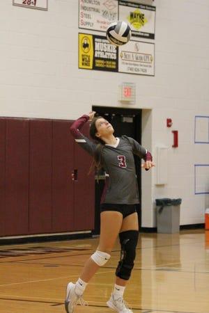 John Glenn's Emma Johnson (3) prepares to serve during Thursday's Muskingum Valley League volleyball match with Morgan at John Glenn High School.