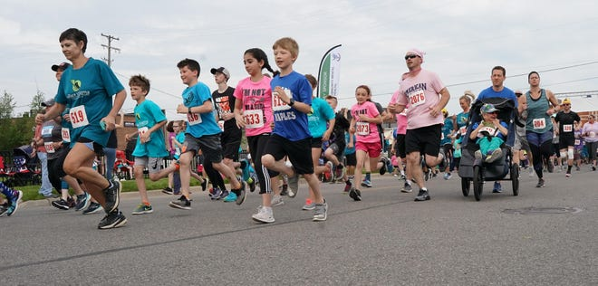 Participants are pictured in the 2019 E-Race the Stigma 5K in downtown Adrian. The 2021 E-Race returns Sunday, Sept. 26, to downtown Adrian.