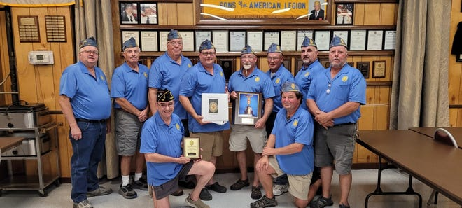 Pictured in the photo are officers of Tecumseh American Legion's Squadron No. 34, with the awards and the scrapbook. From left in the front row kneeling are, Randy Hernandez and Dan Dotson. From left in the back row are, Lynn Gubbe, Randy Sparks, Tom Pollock, Scott Gregory, Kirk Maves, Keith Kapnick, Earl Bolam and Joe Knadler.