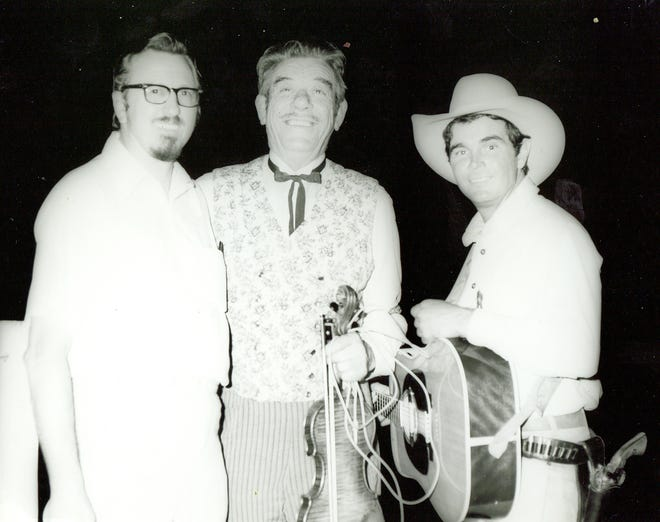 Glenn Strange with Gunsmoke actor Buck Taylor and the late Boot Hill Director George Henrichs.