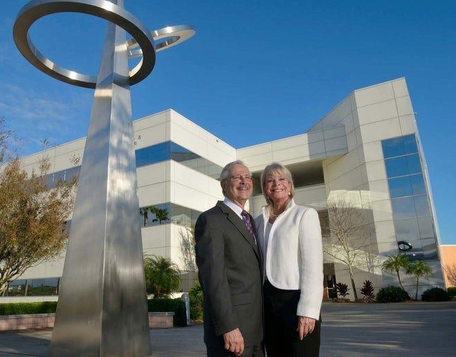 Charles and Elizabeth Duva, who donated $500,000 to an Embry-Riddle Aeronautical University campaign to fund local entrepreneurship, pose on the Daytona Beach campus.