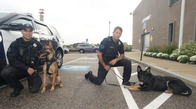 Brockton Police Department two new dogs after 16 weeks in the police academy with Department of Correction head trainer Sergeant Bob Diliddo, Kilo   ,right, and Police Officer Miguel-Otero, and K9 Hawk on Friday, Sept. 24, 2021.