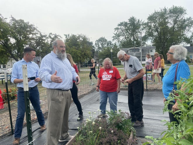 A garden tour at DMACC Newton Campus was among the events Aug. 26 when Iowa State University Extension and Outreach received $85,000 from Amerigroup Iowa for Growing Together Iowa.