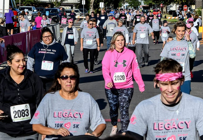 A group of runners and walkers participating in the 2019 Leave a Legacy events make their way toward the finish line in front of the Heartland Cancer Center. After a year off of in-person races due to the COVID-19 pandemic, the popular event returns to Garden City on Oct. 2.