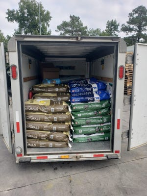 Onslow County nonprofits Piggies by the Sea and the JPR Pet Food Pantry have filled a U-Haul trailer with animal supplies to take to a recovering Louisiana community.