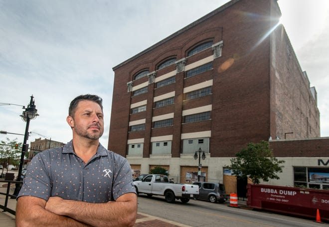 Developer Casey Baldovin stands in front of his latest project, the Federal Building at 800 SW Adams St and Mitchell Fabrics next door at 810 SW Adams in Peoria's Warehouse District. Baldovin is renovating the space into a residential and commercial complex that spans about half the block.