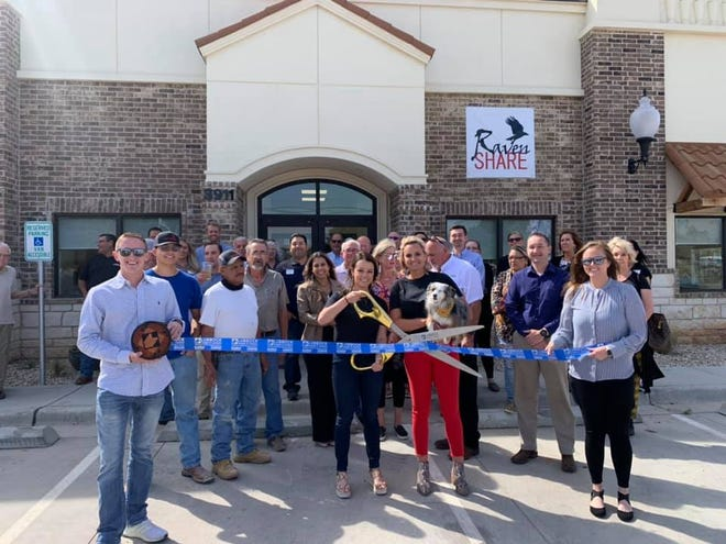 RavenShare by James Morgan Ltd., 3911 98th St. Holding scissors is Jesse Heinrich, Realtor and project administrator. Holding ribbon are Chamber Ambassadors Jaidyn Stagner, left, Kenzi Kinard. Others pictured are Project Manager Holly Richardson, Owners Carl Russell and Larry Elliott, Construction Crew Juan and John Arriaga, Cox & Dirks Architect Michael Zimmerman, Representatives from American Roofing & White Lumber, and other staff, family, friends and Lubbock Chamber Ambassadors.