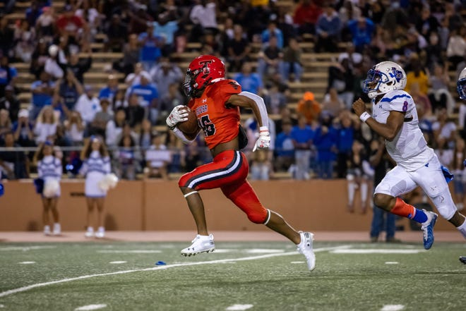 Tascosa's Major Everhart (16) breaks free from defender for a touchdown during a district game Thursday, September 23rd, Palo Duro at Tascosa in Amarillo. Trevor Fleeman/For Amarillo Globe-News.