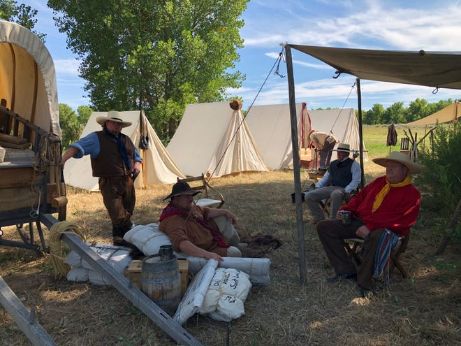 Living historians representing traders from the Arrow Rock Stock and Trading Company set up camp behind Bent's Old Fort National Historic Site during the Santa Fe Trail Symposium.