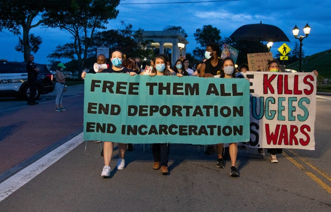 Protesters marched in Plymouth on Thursday, Sept. 23, 2021, calling on the Plymouth County Sheriff to end an agreement in which it holds detainees for U.S. Immigration and Customs Enforcement.