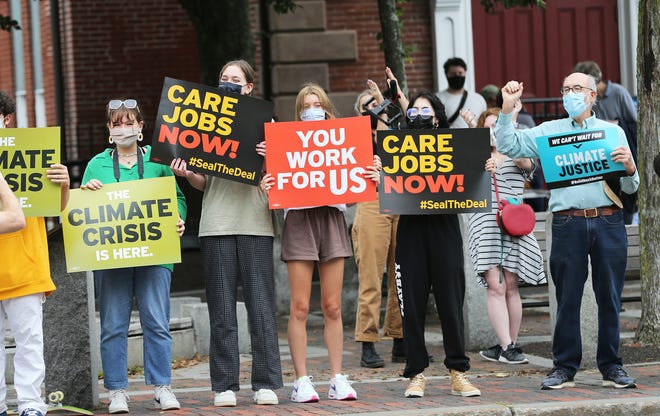 NH State Senator David Watters raises his arm in support of youngsters at the Portsmouth Youth Climate Strike on Sept. 24, 2021 in solidarity with 1,433 other other strikes across the globe.