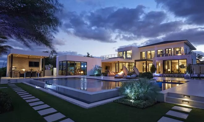 The east side of a house that just sold for a recorded $15.9 million at 3200 Washington Road in West Palm Beach has abundant windows and glass doors overlooking the pool patio, the Intracoastal Waterway and Palm Beach. The recorded price has set a record for single-family sales in the city.