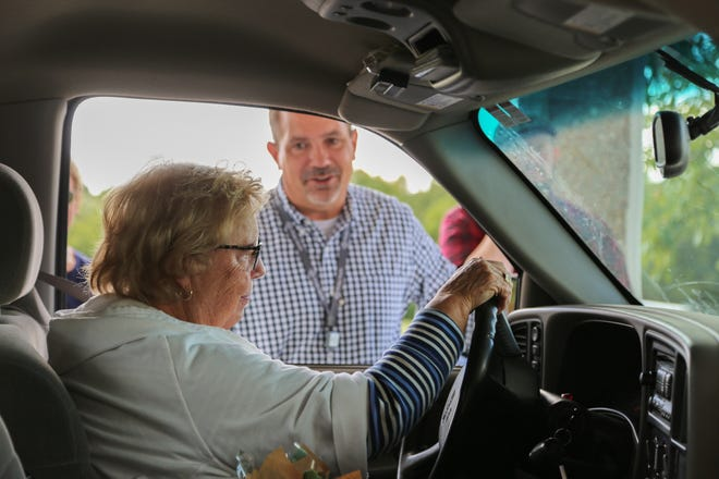 Phelps Health CEO Jason Shenefield greets volunteer Mary Rosenberg during a volunteer appreciation event.