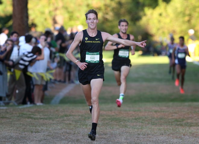 Oregon's Cooper Teare wins the men's cross country race during the Bill Dellinger Invitational at Pine Ridge Golf Club on Thursday.