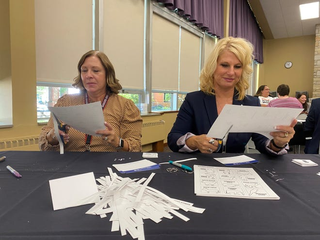 Michelle Balderson and Cathy Brookes put together literacy kits for children in Alliance at the University of Mount Union on Friday, September 24, 2021.