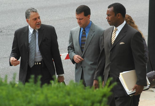 Jeff Pelley with his attorneys Alan Baum, left, and Andre Gammage, right in July 2006.