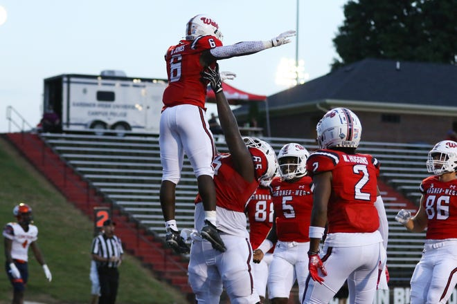 Gardner-Webb football players celebrate after scoring a touchdown in their Sept. 18, 2021 game against Lincoln (Pa.).