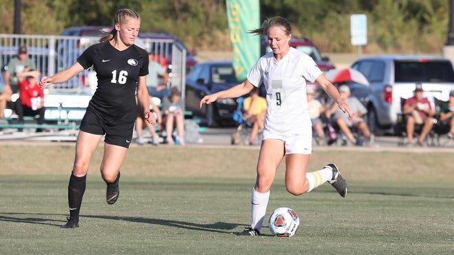Oklahoma Baptist University;s Hannah White (9) controls the soccer ball against East Central Thursday night.