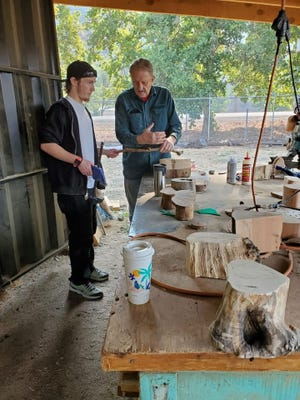 Instructor Ralph Starritt talks to student Jacob Carl during a woodworking class offered by the Siskiyou County Adult Probation Department on Friday, Sept. 17, 2021.