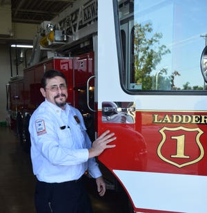Kevin Shook got into the passenger seat of the Kewanee Fire Department's aerial ladder truck Friday to be driven home in a parade of fire department vehicles. Friday was the last day on the job for Shook, a 23-year veteran of the department who had served as chief for the past five years.