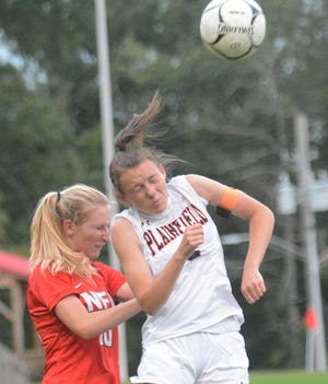 NFA's Kaleigh Andrew and Plainfield's Alysa Penkauskas head the ball Thursday during their game in Norwich.