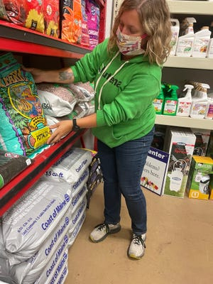 Jennipher Pickford, manager of the Norwich Agway, stocks some popular products that have been used for growing cannabis, including the Fox Farm Ocean Forest soil and the Coast of Maine Grower's Blend Fertilizer.