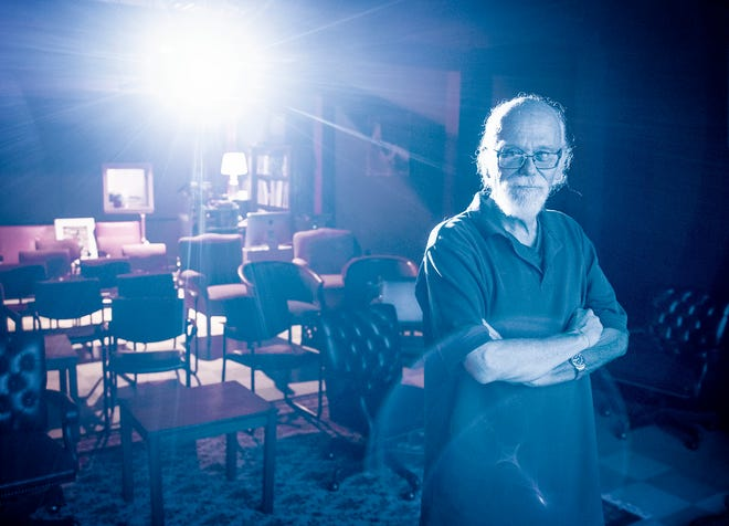 """Steve Sandberg is illuminated by a projector in the Front Room at WCUW Sept. 23. Sandberg's Cinema 320 at WCUW Radio debuted Sept. 24 with a screening of """"On Broadway."""""""