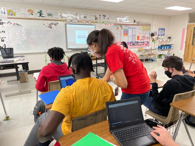 Seventy-First High School Chinese language teacher Alice Chen assists a student during class.