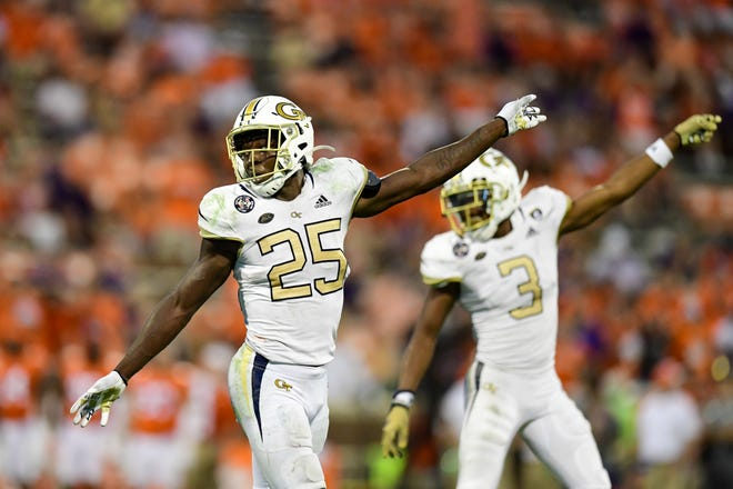 Georgia Tech linebacker Charlie Thomas, left, and defensive back Tre Swilling signal for a turnover in the Yellow Jackets' favor against Clemson during the second half of last week's game.