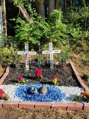 Memorial flowers planted for Dan and Mose by their families.