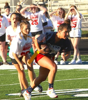 BNL senior Makayla Turner runs the ball into the end zone after making a catch as BNL freshmen pursue. The annual BNL Powderpuff Flag Football game occurred Thursday evening as a prelude to BNL's Homecoming matchup with Jennings County on Friday.