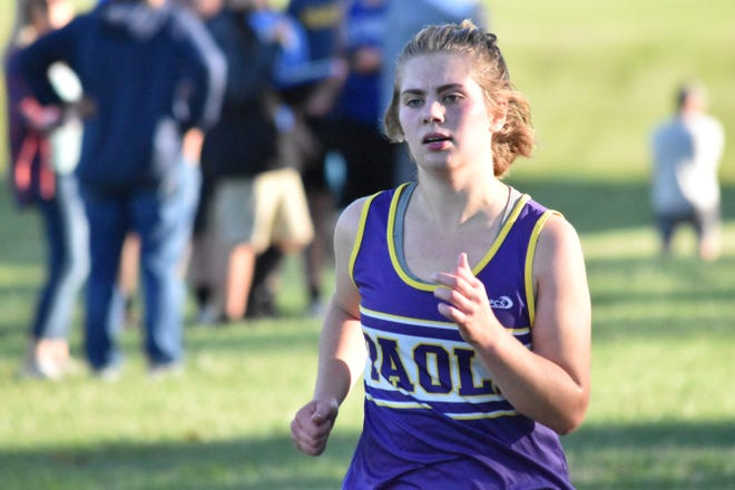 Paoli's Hannah Albertson approaches the finish line on her way to a third-place finish at the 2021 Paoli Cross Country Invite.