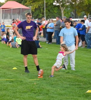 Five-year-old Lydia Aldren gave a good punt during the Punt, Pass and Kick event.