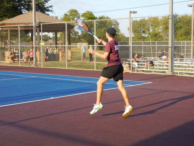 Ennis boys singles player Chance Kozlosky wins his match against Corsicana on Tuesday.
