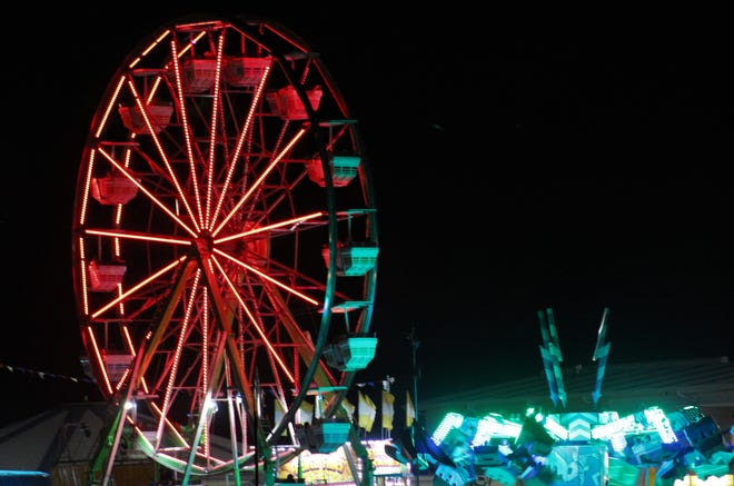 The Ferris wheel at the West Texas Fair & Rodeo lights the night sky Sept. 18. The Taylor County Expo Center was packed that night, on a way to a huge financial climb from 2020.