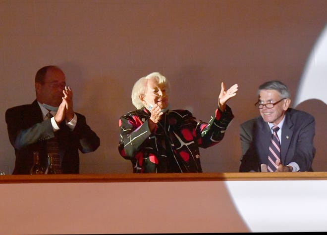 Lale Estes thanks signals her thanks from the balcony during Thursday's Chamber of Commerce banquet at the Abilene Convention Center. Lale and her late husband, Dr. B.J. Estes, were named as the Chamber's 2021 Outstanding Citizens of the Year.